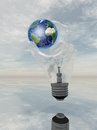 Light bulb hand and earth holds Royalty Free Stock Images
