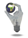 Light bulb hand holds earth showing africa middle east and europe Stock Images