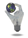 Light bulb hand holds earth showing north and south america Royalty Free Stock Photography