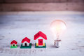 Light bulb with house model Royalty Free Stock Photo