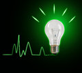 Light bulb idea on green Royalty Free Stock Images