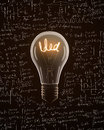 Light bulb with idea text isolated on mathematics formula backgrounds Stock Photography