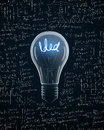 Light bulb with idea text on mathematics formula backgrounds Royalty Free Stock Image