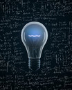 Light bulb with idea text on mathematics formula backgrounds Royalty Free Stock Images