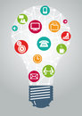 Light bulb ideas and communication graphic featuring a with business technology icons inside Stock Photos