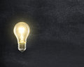 Light bulb lamp on blackboard Royalty Free Stock Photo