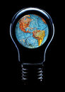Light bulb with planet earth isolated on black background Stock Image
