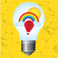 Light bulb with rainbow Royalty Free Stock Photo