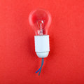 Light bulb on red paper Royalty Free Stock Photo