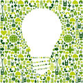 Light bulb symbol with green icons background Stock Photo