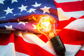 Light bulb on USA flag lighting Royalty Free Stock Photo