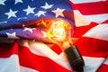 Light bulb on USA flag lighting Royalty Free Stock Photo