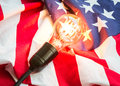 Light bulb on USA flag on white background Royalty Free Stock Photo