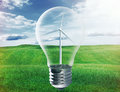 Light bulb with wind turbine inside Royalty Free Stock Photo