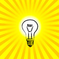 Light bulb on yellow background Royalty Free Stock Photos