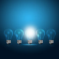 Light bulbs with glowing one Royalty Free Stock Photos