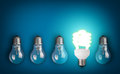 Light bulbs idea concept with row of Royalty Free Stock Photos