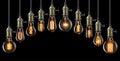 Light bulbs set of vintage glowing on black Stock Image