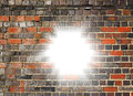 Light bursting through a brick wall Royalty Free Stock Photo