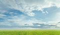 Light clouds on blue sky at summer sunny day beautiful skyscape over the green meadow Royalty Free Stock Images