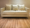 Light Cream Modren Sofa on Wood Floor Royalty Free Stock Image