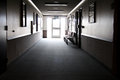 Light at the end of the hallway image a bright a darkened Royalty Free Stock Photo