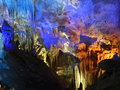 Light fairy show in the cave of prometheus cascade stalactites and stalagmites a lamplight Stock Photo