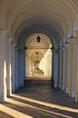 Light that filters through the Road downhill porticos Stock Photos