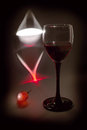 Light, glass and grape (black key still life) Royalty Free Stock Photos