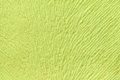 Light green background from soft textile material. Fabric with natural texture. Royalty Free Stock Photo