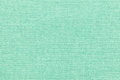 Light green background from a textile material with wicker pattern, closeup. Royalty Free Stock Photo