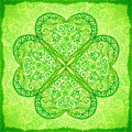 Light green ornate four-leaf clover background Stock Images