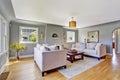 Light grey living room with white sofas