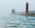 Light house at grand haven michigan state park with fog rolling in Royalty Free Stock Photo