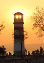 Light house at sundown a on a big lake the Royalty Free Stock Images