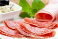 Light meal of salami, ham and feta cheese Stock Photography