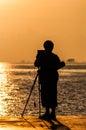 Light morning shadow of a man at sea. Royalty Free Stock Photo