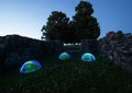 Light painting sphere hemisphere circular lights ruin evening art meadow flowers deciduous stone wall Royalty Free Stock Photo