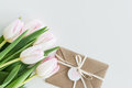Light pink tulips and envelope isolated on white with copy space