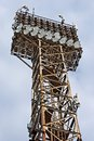 Light projectors on old rust metal tower Stock Images