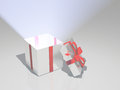 Light radiates from open box gift Stock Photo