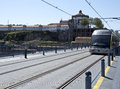 Light rail system crossing the historical dom luis bridge in porto portugal Royalty Free Stock Image