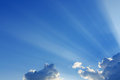 Light rays on blue sky background Royalty Free Stock Photo