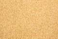 Light red coarse sand closeup view from the top of river which is in color Royalty Free Stock Photo