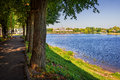 Light shade of tver the volga river in the sun and on the waterfront walkway in the Royalty Free Stock Image