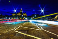 Light streaks across a bridge Royalty Free Stock Image