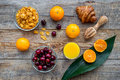 Light summer breakfast. Muesli, oranges, cherry and croissant on wooden table background top view