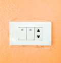 Light switch broad on orange wall Royalty Free Stock Photo