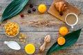 Light tasty breakfast. Muesli, oranges, cherry, french croissant, milky coffee on wooden background top view copyspace