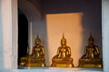 The light to the sitting golden buddha in the temple in thailand at yai suwannaram petchaburi Royalty Free Stock Photo